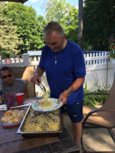ralph serving his pasta