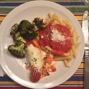sheet pan sausage parmesan with garlicky broccoli