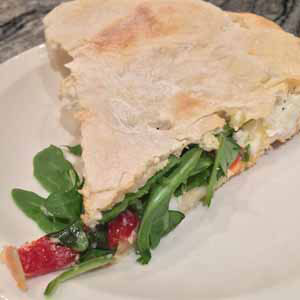 sicilian stuffed pizza with ricotta and arugula